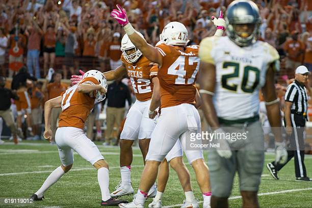 Trent Domingue of the Texas Longhorns celebrates with teammates after kicking a field goal to put the Longhorns ahead 3534 against the Baylor Bears...