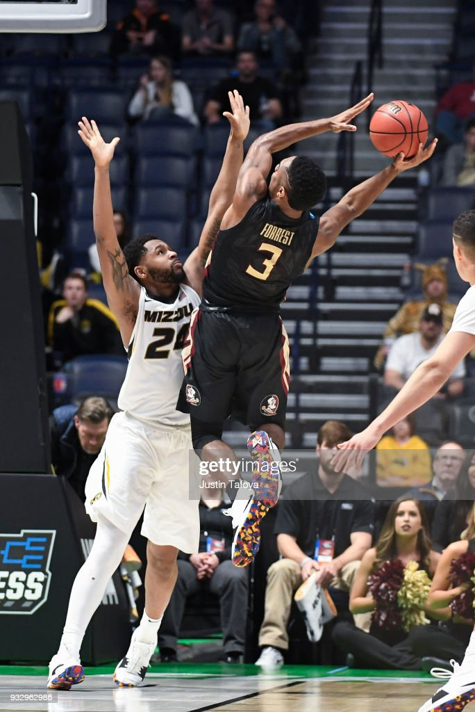 Trent Forrest #3 of the Florida State Seminoles attempts to score against the Missouri Tigers in the first round of the 2018 NCAA Men's Basketball Tournament held at Bridgestone Arena on March 16, 2018 in Nashville, Tennessee.
