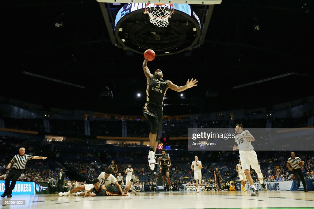 Trent Forrest #3 of the Florida State Seminoles dunks the ball against the Missouri Tigers during the game in the first round of the 2018 NCAA Men's Basketball Tournament at Bridgestone Arena on March 16, 2018 in Nashville, Tennessee.