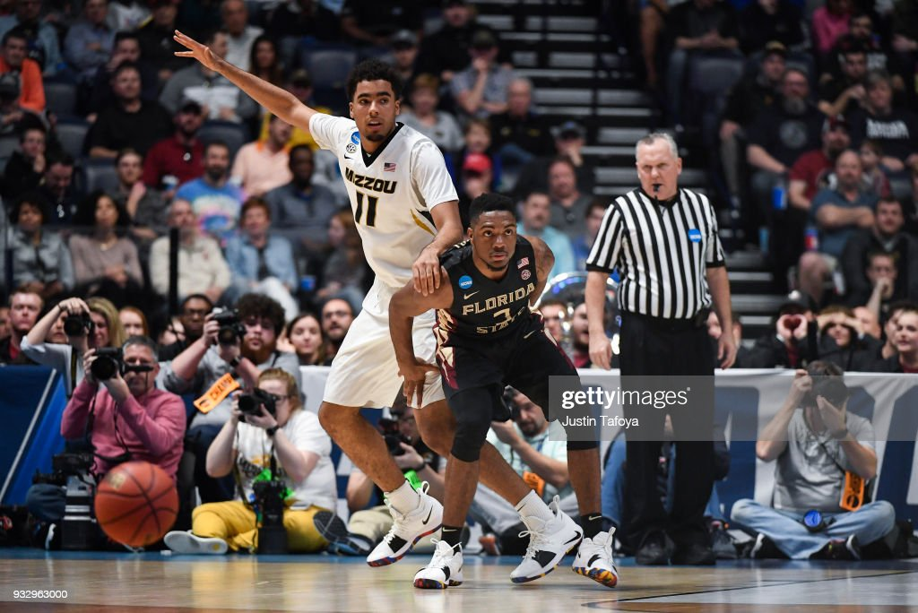 Trent Forrest #3 of the Florida State Seminoles playing defense against Jontay Porter #11 of the Missouri Tigers trying to get open in the first round of the 2018 NCAA Men's Basketball Tournament held at Bridgestone Arena on March 16, 2018 in Nashville, Tennessee.