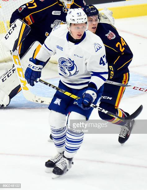 Trent Fox of the Mississauga Steelheads turns up ice against Tyler MacArthur of the Barrie Colts during OHL game action on December 8 2017 at Hershey...