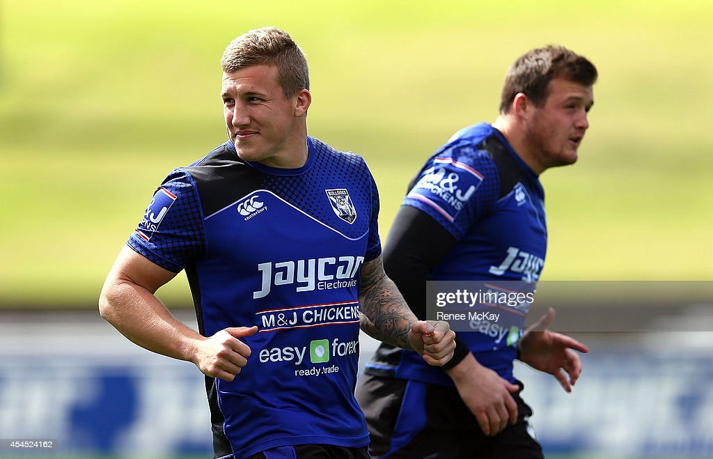 Trent Hodkinson and Josh Morris warm up during a Canterbury Bulldogs NRL training session at Belmore Sports Ground on September 3, 2014 in Sydney, Australia.