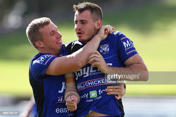 Trent Hodkinson and Josh Reynolds joke around during a Canterbury Bulldogs NRL training session at Belmore Sports Ground on May 8 2014 in Sydney...