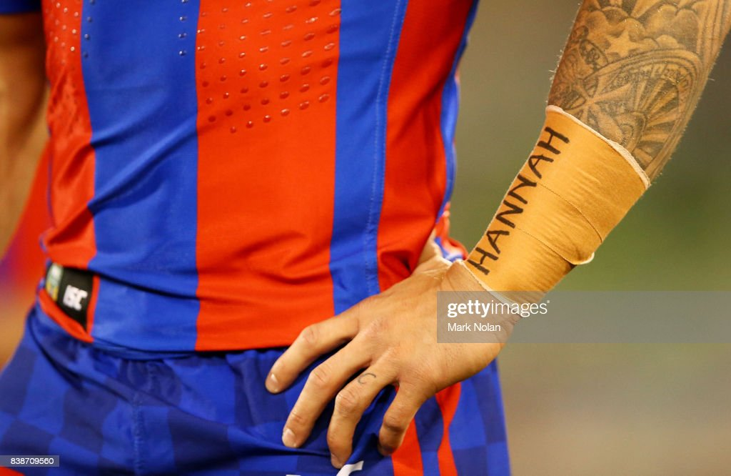 Trent Hodkinson of the Knights is pictured with 'Hannah' on his forearm taping out of respect for the passing of Hannah Rye during the round 25 NRL match between the Canberra Raiders and the Newcastle Knights at GIO Stadium on August 25, 2017 in Canberra, Australia.