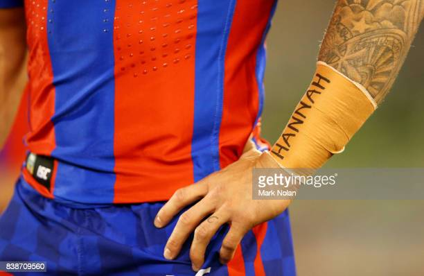 Trent Hodkinson of the Knights is pictured with 'Hannah' on his forearm taping out of respect for the passing of Hannah Rye during the round 25 NRL...