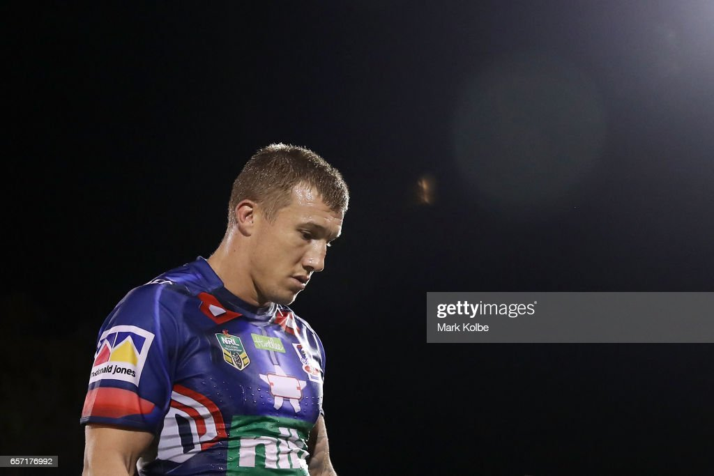 Trent Hodkinson of the Knights looks dejected as he leaves the field after defeat during the round four NRL match between the Penrith Panthers and the Newcastle Knights at Pepper Stadium on March 24, 2017 in Sydney, Australia.