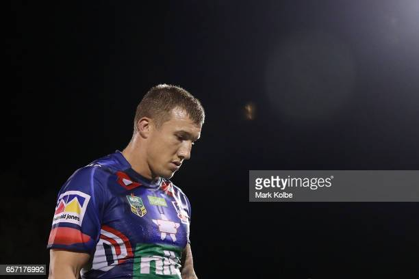 Trent Hodkinson of the Knights looks dejected as he leaves the field after defeat during the round four NRL match between the Penrith Panthers and...