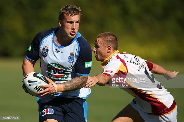 Trent Hodkinson runs the ball during an opposed session against North Coast group 3 team during the New South Wales Blues State of Origin training...