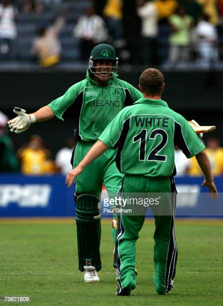 Trent Johnston of Ireland celebrates with Andrew White after the winning runs secured victory over Pakistan during the ICC Cricket World Cup 2007...