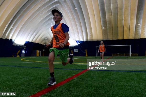 Trent Justis sprints down a painted line while playing a game of PacMan during Adventure Day Camp in the Dome at the Sports Dome on July 11 in...