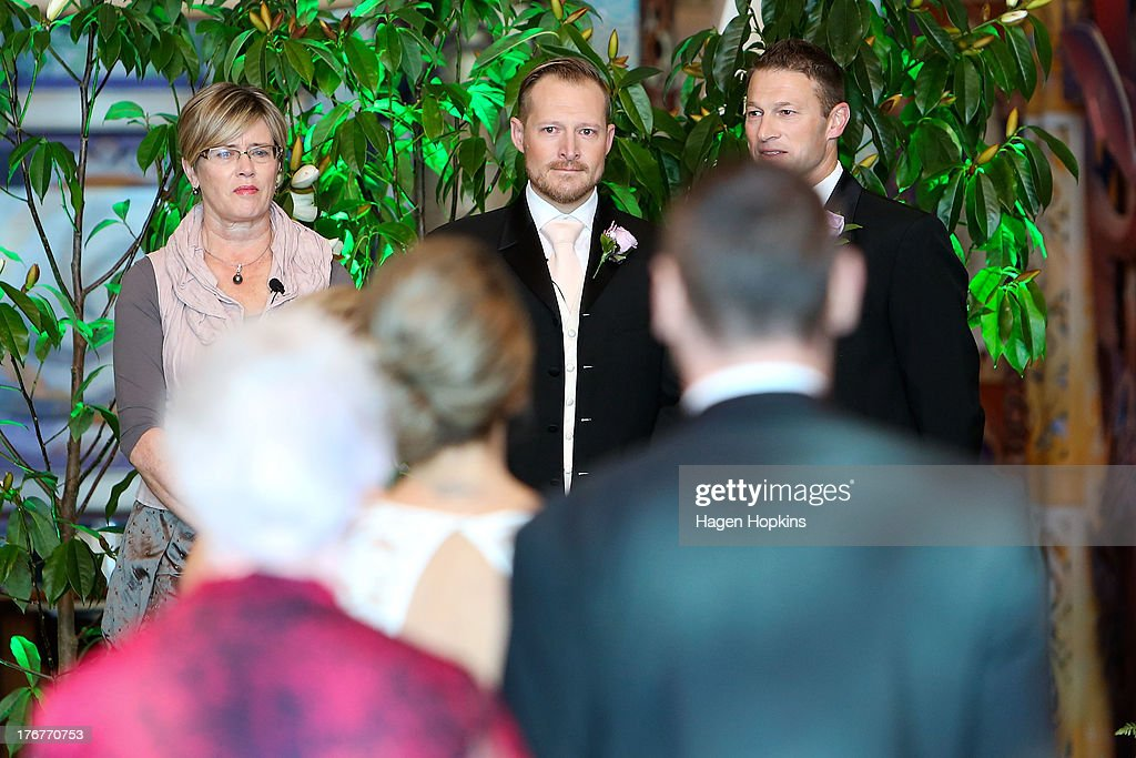 Trent Kandler looks on while Paul McCarthy arrives during their marriage ceremony at the Museum of New Zealand, Te Papa, on August 19, 2013 in Wellington, New Zealand. Australian gay couple Paul McCarthy and Trent Kandler were flown to Wellington by Tourism New Zealand in a promotion to highlight to Australians that same-sex marriage is legal in New Zealand.