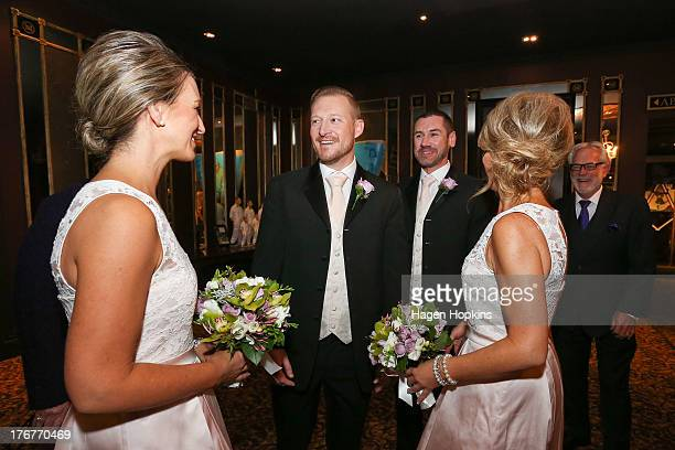Trent Kandler talks to his matron of honour Tracey Moloney while husbandtobe Paul McCarthy and flower girl Amanda Wenham look on at the Museum Hotel...