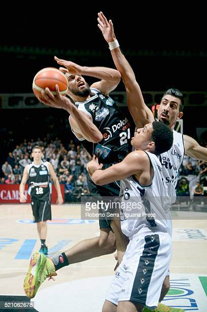 Trent Lockett of Dolomiti Energia competes with Abdul Gaddy and Valerio Mazzola of Obiettivo Lavoro during the LegaBasket match between Virtus...
