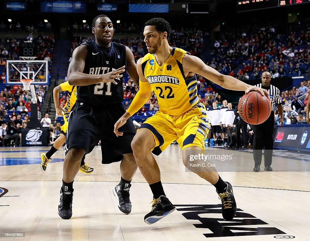 Trent Lockett #22 of the Marquette Golden Eagles handles the ball against Roosevelt Jones #21 of the Butler Bulldogs in the second half during the third round of the 2013 NCAA Men's Basketball Tournament at Rupp Arena on March 23, 2013 in Lexington, Kentucky.