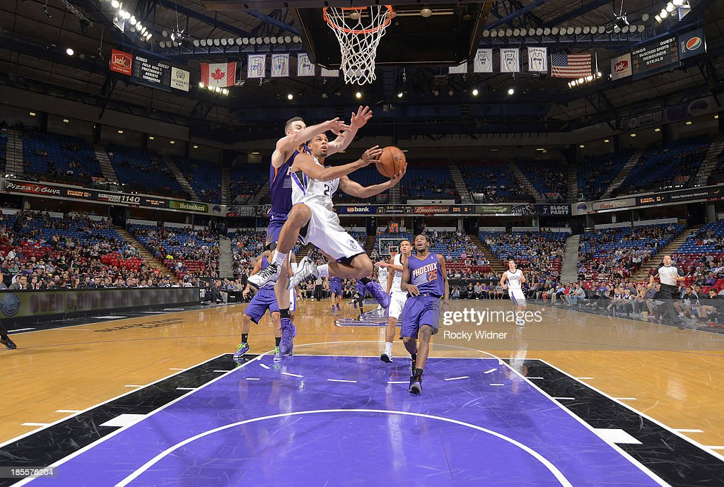 <a gi-track='captionPersonalityLinkClicked' href=/galleries/search?phrase=Trent+Lockett&family=editorial&specificpeople=6541121 ng-click='$event.stopPropagation()'>Trent Lockett</a> #20 of the Sacramento Kings goes up for the shot against <a gi-track='captionPersonalityLinkClicked' href=/galleries/search?phrase=Miles+Plumlee&family=editorial&specificpeople=5645212 ng-click='$event.stopPropagation()'>Miles Plumlee</a> #22 of the Phoenix Suns on October 17, 2013 at Sleep Train Arena in Sacramento, California.