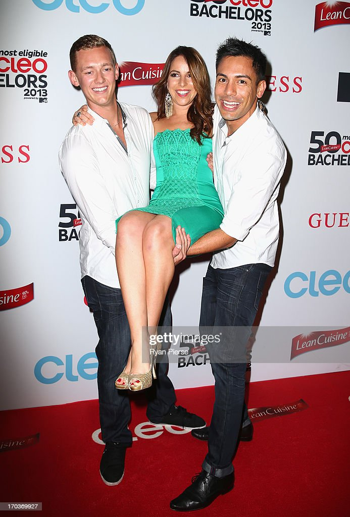 Trent Maxwell and Reuben Mourad hold Sharri Markson at the CLEO Bachelor of the Year Awards on June 12, 2013 in Sydney, Australia.
