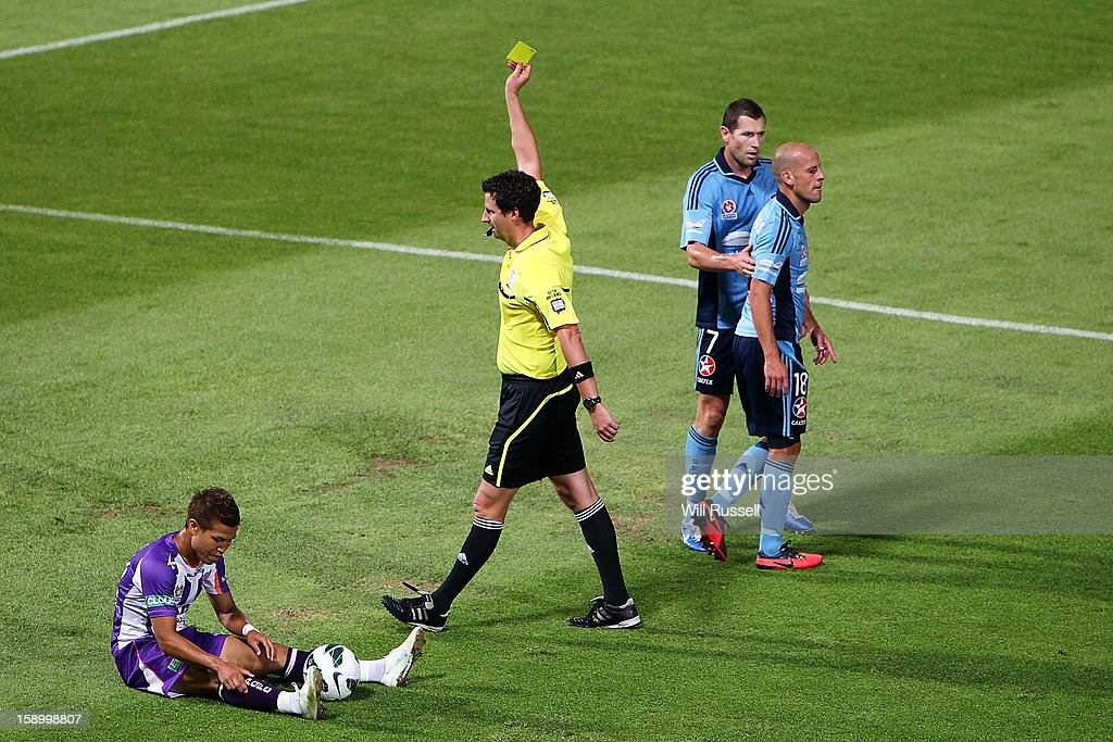Trent McClenahan of Sydney is shown the yellow card after a tackle to Ryo Nagai of the Glory during the round 15 A-League match between the Perth Glory and Sydney FC at nib Stadium on January 5, 2013 in Perth, Australia.