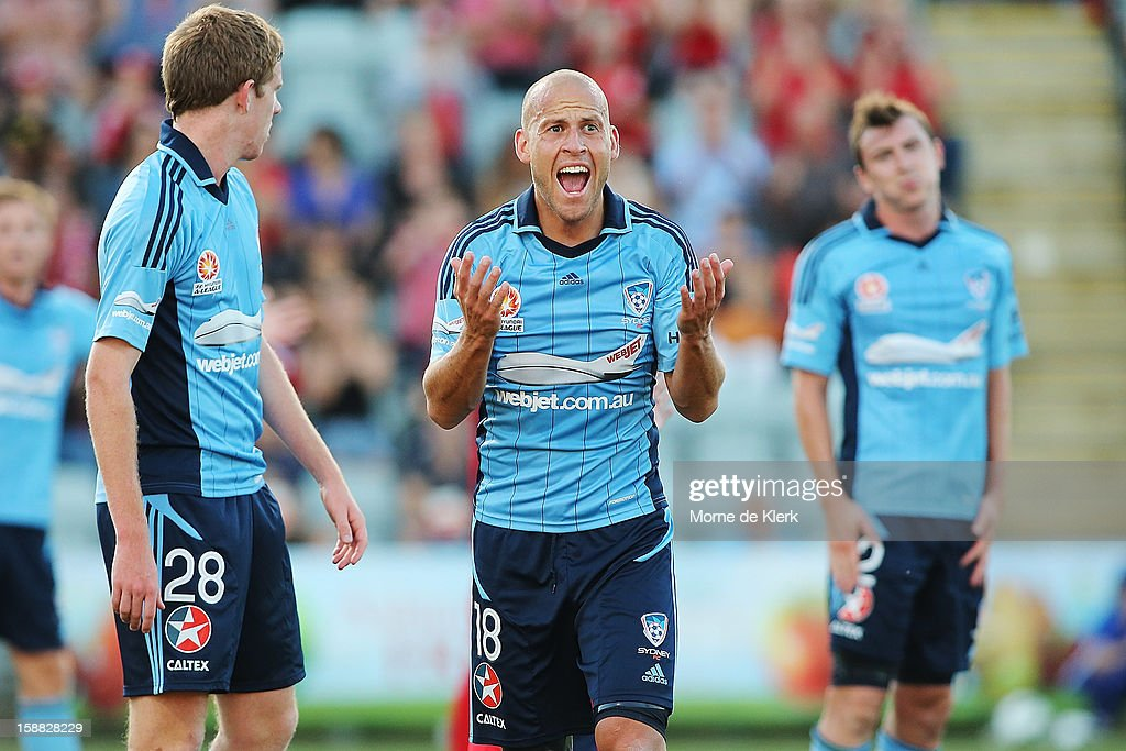 Trent McClenahan (C) of Sydney reacts after Adelaide won a penalty kick during the round 14 A-League match between Adelaide United and Sydney FC at Hindmarsh Stadium on December 31, 2012 in Adelaide, Australia.