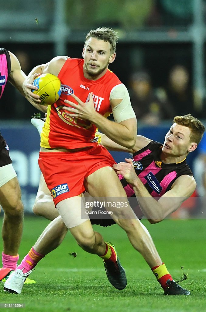 Trent McKenzie of the Suns is tackled by Tim O'Brien of the Hawks during the round 14 AFL match between the Hawthorn Hawks and the Gold Coast Suns at Aurora Stadium on June 26, 2016 in Launceston, Australia.