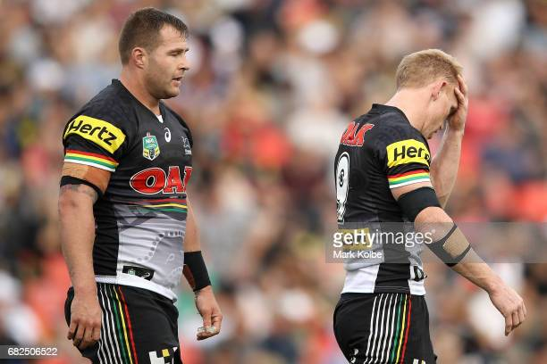 Trent Merrin and Peter Wallace of the Panthers look dejected after a Warriors try during the round 10 NRL match between the Penrith Panthers and the...