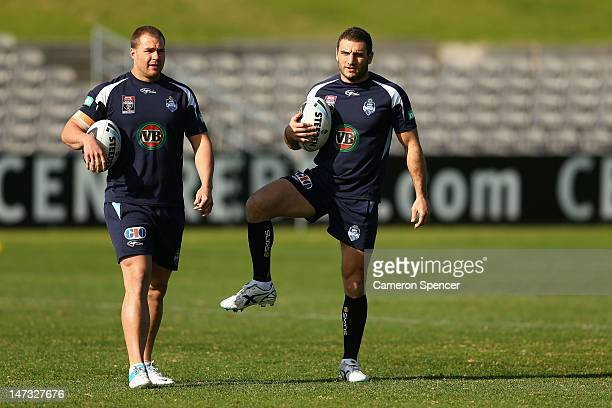 Trent Merrin and Robbie Farah of the Blues warm up during a New South Wales Blues state of origin training session at WIN Jubilee Stadium on June 28...