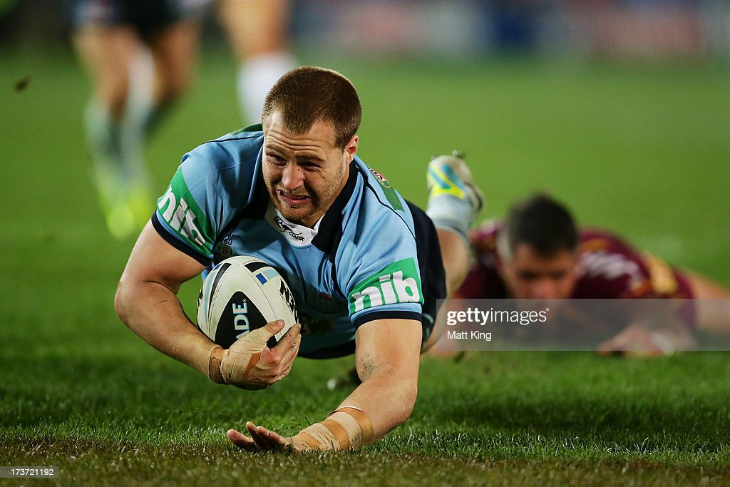 Trent Merrin of the Blues dives over to score a try during game three of the ARL State of Origin series between the New South Wales Blues and the Queensland Maroons at ANZ Stadium on July 17, 2013 in Sydney, Australia.
