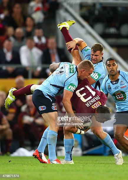 Trent Merrin of the Blues tackles Corey Parker of the Maroons during game three of the State of Origin series between the Queensland Maroons and the...