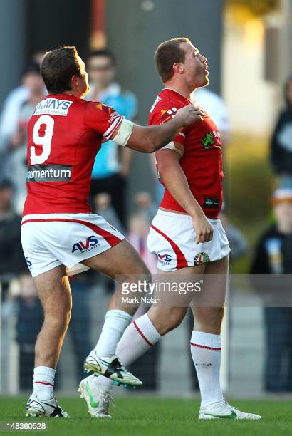 Trent Merrin of the Dragons celebrates his try during the round 19 NRL match between the St George Illawara Dragons and the Cronulla Sharks at WIN...