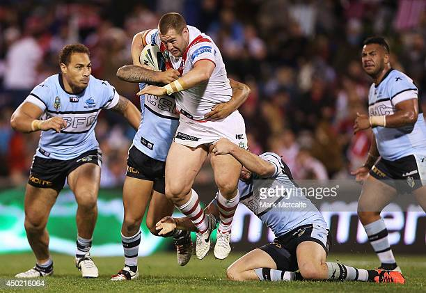 Trent Merrin of the Dragons is tackled during the round 13 NRL match between the St George Illawarra Dragons and the CronullaSutherland Sharks at WIN...