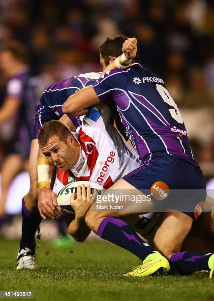 Trent Merrin of the Dragons is tackled during the round 16 NRL match between the St George Illawarra Dragons and the Melbourne Storm at WIN Stadium...