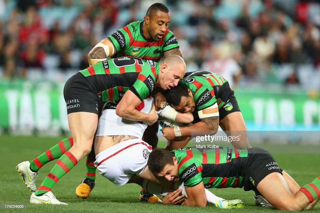 Trent Merrin of the Dragons is tackled during the round 19 NRL match between the South Sydney Rabbitohs and the St George Illawarra Dragons at ANZ Stadium on July 22, 2013 in Sydney, Australia.