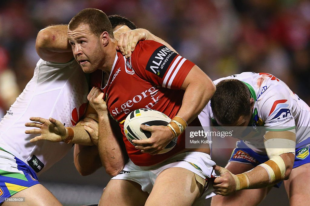 <a gi-track='captionPersonalityLinkClicked' href=/galleries/search?phrase=Trent+Merrin&family=editorial&specificpeople=5881493 ng-click='$event.stopPropagation()'>Trent Merrin</a> of the Dragons is tackled during the round 20 match between the St George Illawarra Dragons and the Canberra Raiders at WIN Stadium on July 27, 2013 in Wollongong, Australia.