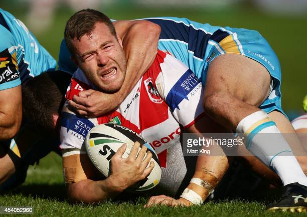 Trent Merrin of the Dragons is tackled during the round 24 NRL match between the St George Illawarra Dragons and the Gold Coast Titans at WIN Jubilee...