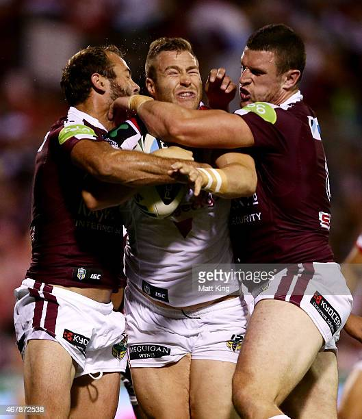 Trent Merrin of the Dragons is tackled during the round four NRL match between the St George Illawarra Dragons and the Manly Warringah Sea Eagles at...