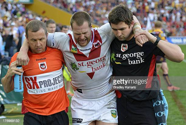 Trent Merrin of the Dragons is taken from the field injured during the round 22 NRL match between the Brisbane Broncos and the St George Illawarra...
