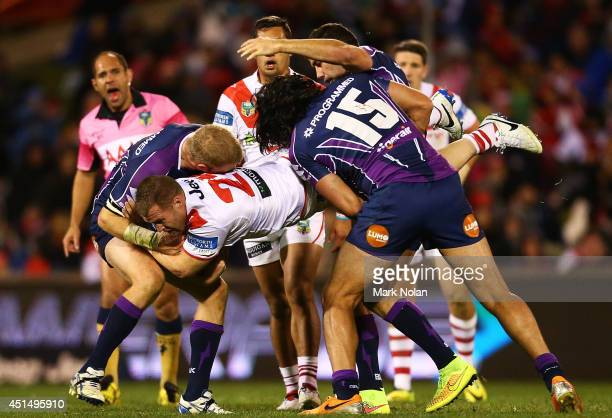 Trent Merrin of the Dragons is up ended during the round 16 NRL match between the St George Illawarra Dragons and the Melbourne Storm at WIN Stadium...