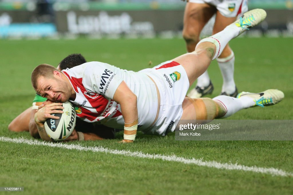 Trent Merrin of the Dragons scores a try during the round 19 NRL match between the South Sydney Rabbitohs and the St George Illawarra Dragons at ANZ Stadium on July 22, 2013 in Sydney, Australia.