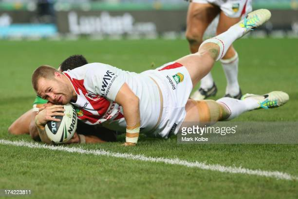 Trent Merrin of the Dragons scores a try during the round 19 NRL match between the South Sydney Rabbitohs and the St George Illawarra Dragons at ANZ...