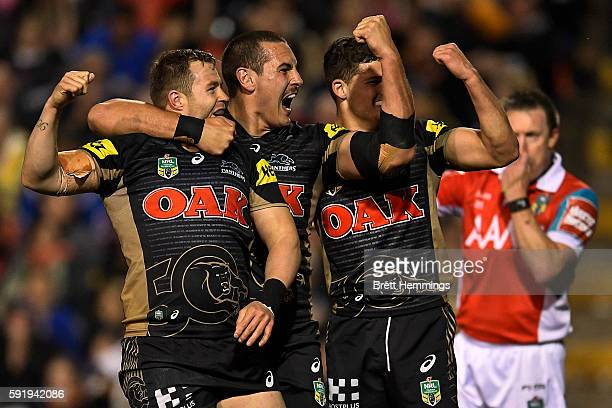 Trent Merrin of the Panthers celebrates scoring a try with team mates during the round 24 NRL match between the Penrith Panthers and the Wests Tigers...