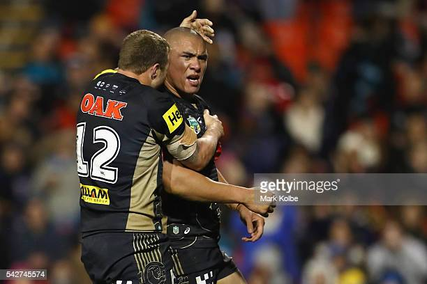 Trent Merrin of the Panthers celebrates with Leilani Latu of the Panthers as he celebrates scoring a try during the round 16 NRL match between the...