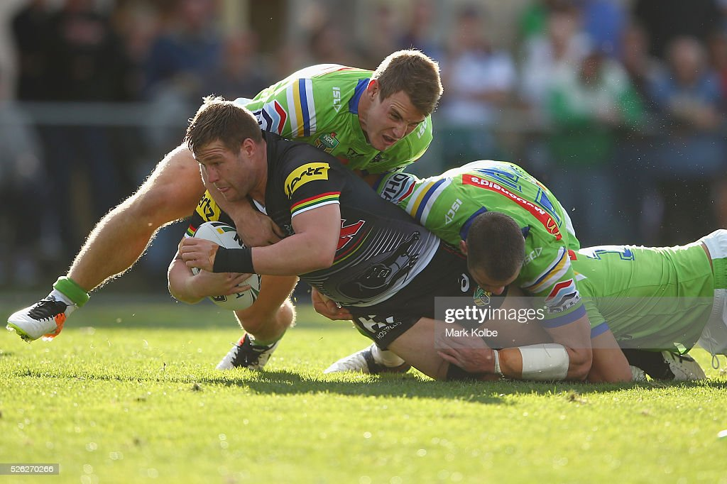 <a gi-track='captionPersonalityLinkClicked' href=/galleries/search?phrase=Trent+Merrin&family=editorial&specificpeople=5881493 ng-click='$event.stopPropagation()'>Trent Merrin</a> of the Panthers is tackled during the round nine NRL match between the Penrith Panthers and the Canberra Raiders at Carrington Park on April 30, 2016 in Bathurst, Australia.