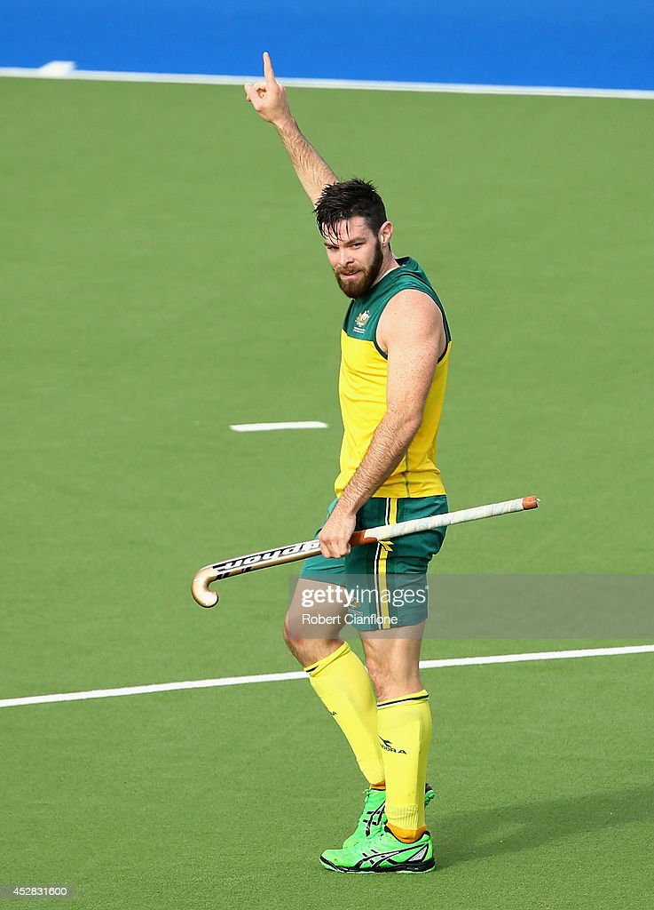<a gi-track='captionPersonalityLinkClicked' href=/galleries/search?phrase=Trent+Mitton&family=editorial&specificpeople=5668433 ng-click='$event.stopPropagation()'>Trent Mitton</a> of Australia celebrates after scoring his second goal during the Men's preliminaries match between South Africa and Australia at Glasgow National Hockey Centre during day five of the Glasgow 2014 Commonwealth Games on July 28, 2014 in Glasgow, United Kingdom.