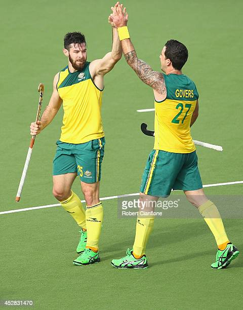 Trent Mitton of Australia celebrates with Kieran Govers after scoring his second goal during the Men's preliminaries match between South Africa and...