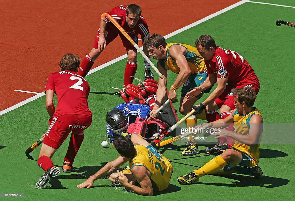 Trent Mitton of Australia loses his stick as he competes for the ball during the match between Australia and Belgium on day one of the Champions Trophy on December 1, 2012 in Melbourne, Australia.