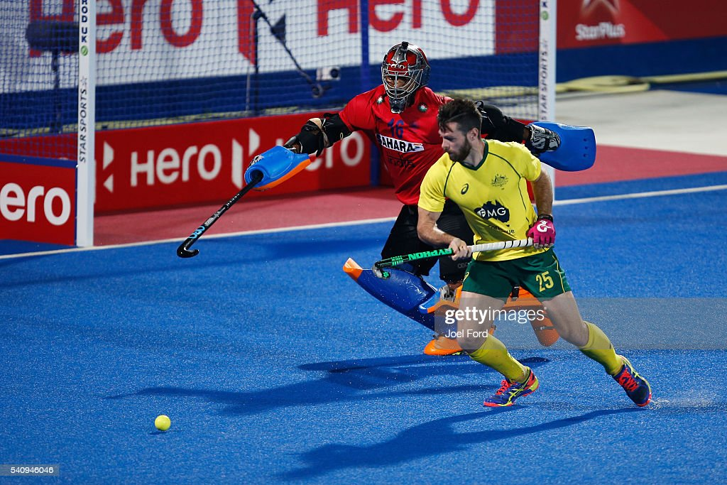 <a gi-track='captionPersonalityLinkClicked' href=/galleries/search?phrase=Trent+Mitton&family=editorial&specificpeople=5668433 ng-click='$event.stopPropagation()'>Trent Mitton</a> of Australia takes a penalty against goalkeeper Harmanpreet Singh of India during a shootout of the FIH Men's Hero Hockey Champions Trophy 2016 final between Australia and India at Queen Elizabeth Olympic Park on June 17, 2016 in London, England.