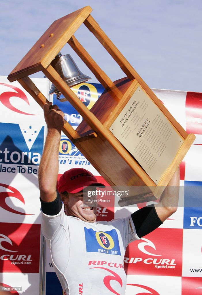 Trent Munro of Australia hold aloft the Bells Trophy after winning the final of the Rip Curl Pro which is round two of the ASP World Championship...