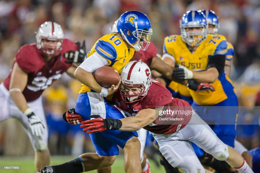 Trent Murphy of the Stanford Cardinal sacks Nick Fales of the San Jose State Spartans during an NCAA football game played on September 7 2013 at...