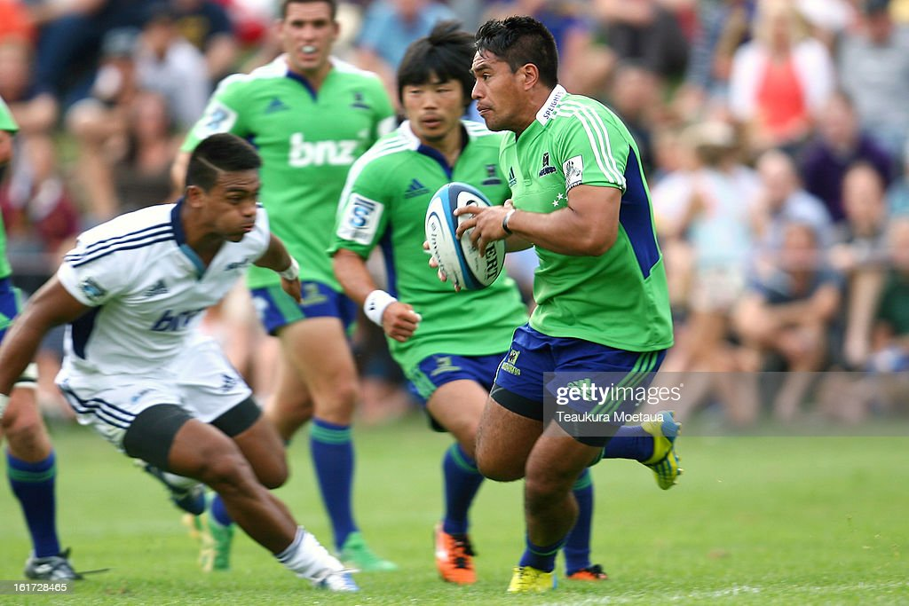 Trent Renata of the Highlanders makes a break during the Super Rugby trial match between the Highlanders and the Blues at the Queenstown Recreation Ground on February 15, 2013 in Queenstown, New Zealand.