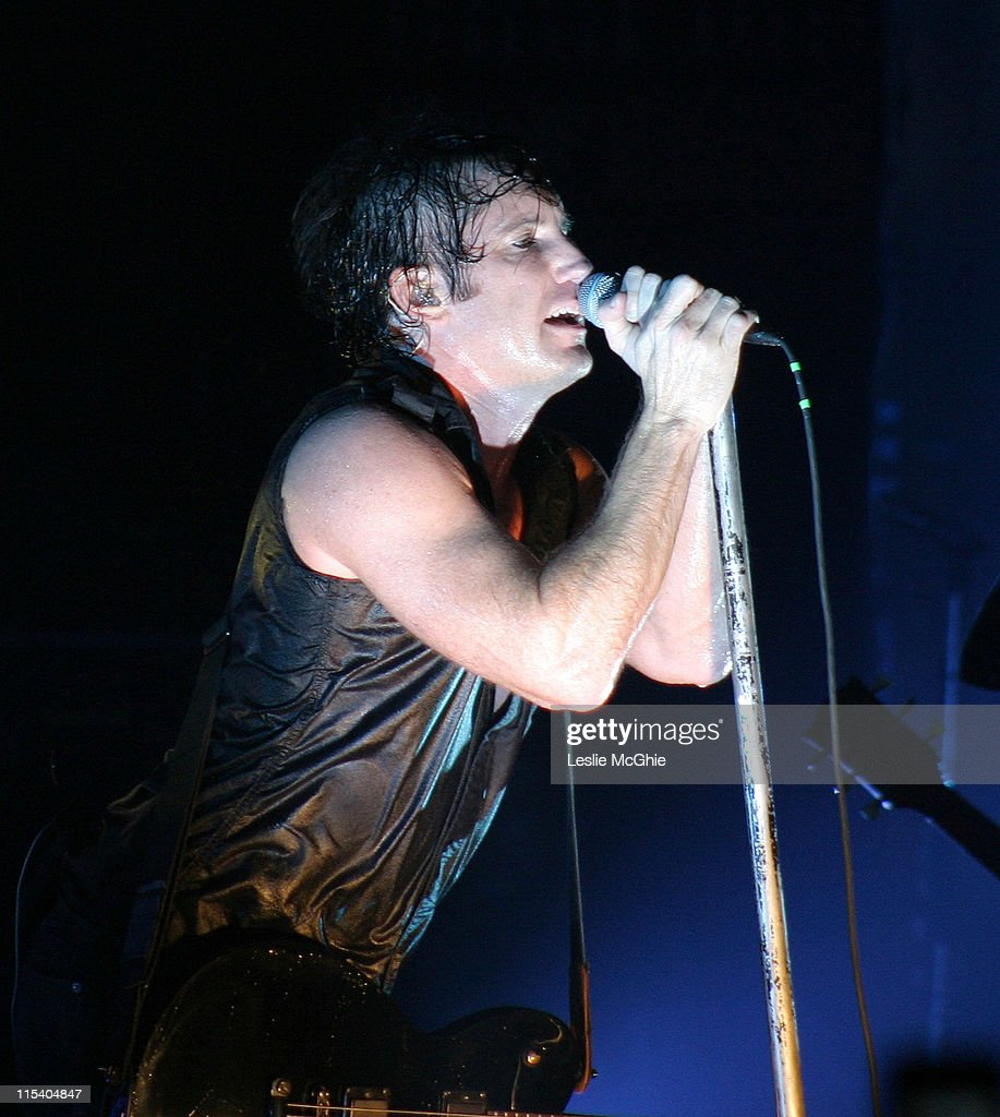 <a gi-track='captionPersonalityLinkClicked' href=/galleries/search?phrase=Trent+Reznor&family=editorial&specificpeople=239036 ng-click='$event.stopPropagation()'>Trent Reznor</a> of <a gi-track='captionPersonalityLinkClicked' href=/galleries/search?phrase=Nine+Inch+Nails&family=editorial&specificpeople=799973 ng-click='$event.stopPropagation()'>Nine Inch Nails</a> during <a gi-track='captionPersonalityLinkClicked' href=/galleries/search?phrase=Nine+Inch+Nails&family=editorial&specificpeople=799973 ng-click='$event.stopPropagation()'>Nine Inch Nails</a> in Concert at the Brixton Academy in London - July 14, 2005 at Brixton Academy in London, Great Britain.