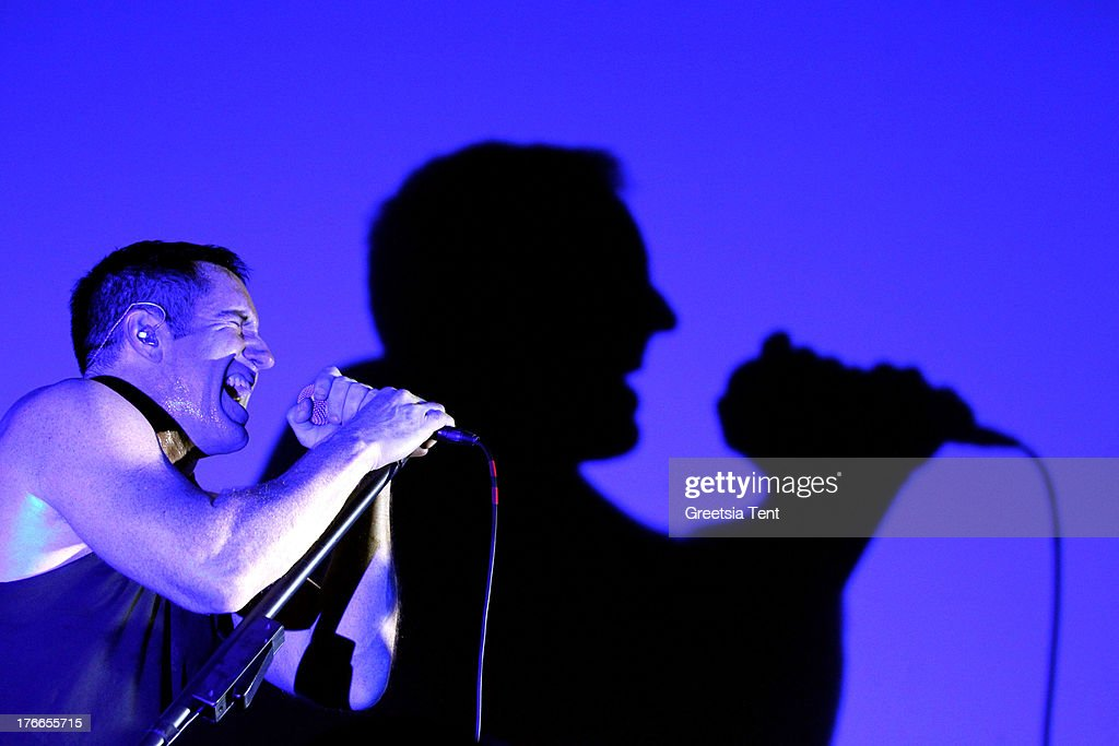 <a gi-track='captionPersonalityLinkClicked' href=/galleries/search?phrase=Trent+Reznor&family=editorial&specificpeople=239036 ng-click='$event.stopPropagation()'>Trent Reznor</a> of Nine Inch Nails performs at day one of the Lowlands Festival on August 16, 2013 in Biddinghuizen, Netherlands.
